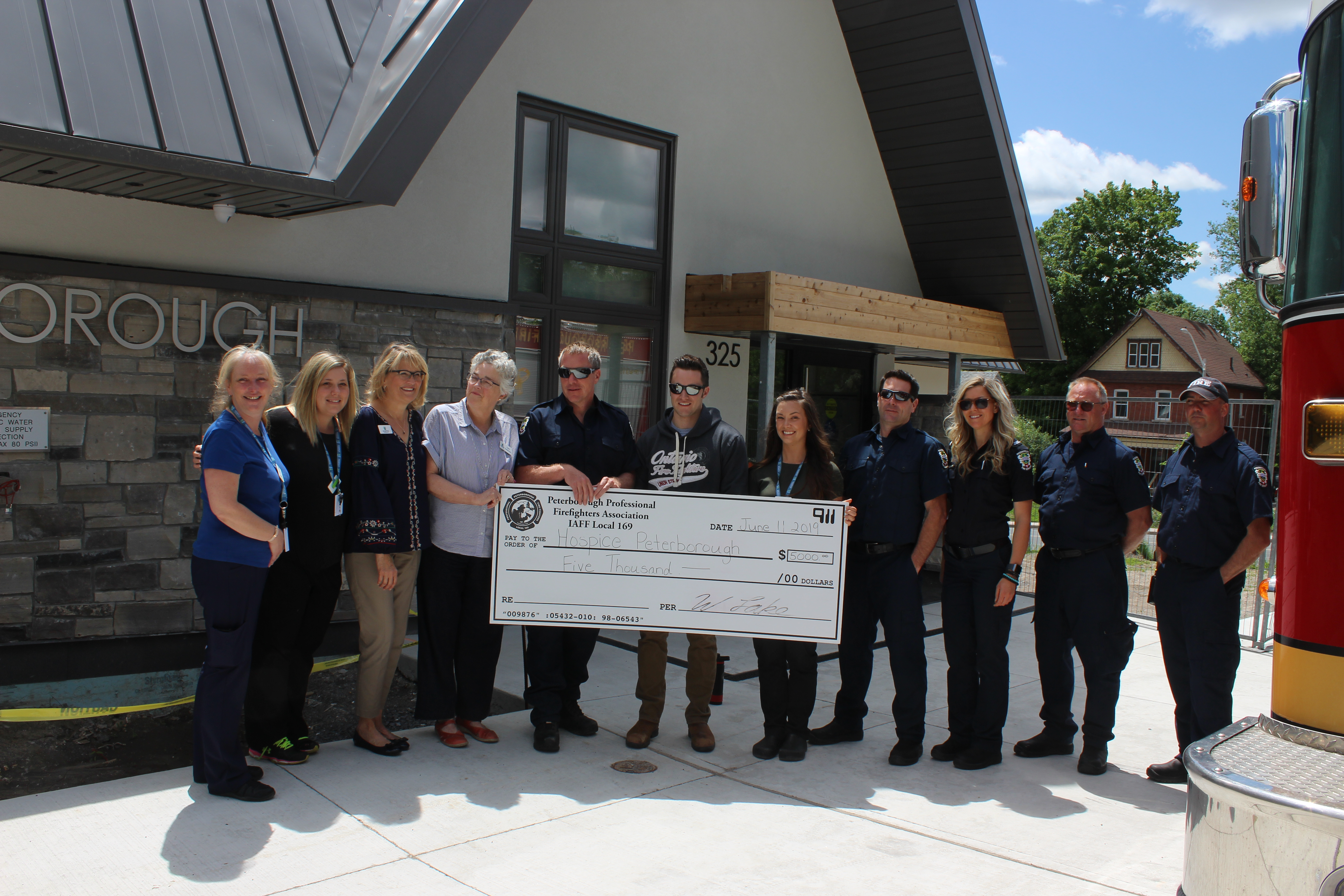 Photo of PPFA cheque presentation - Pictured (left to right): Jody Taylor, Sarah Youmans, Shelley Barrie, Linda Sunderland, Joe O'Brien, Mike O'Brien, Alley Heard, Jason Cooper, Amanda Nichols, Herb Koning, Ian Robertson.